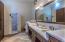 double sinks, shower, storage