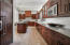 Sleek customized kitchen with Viking appliances and white marble counter tops