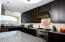 Granite counter tops, large dark wood cabinetry