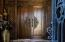 Dramatic carved entry doors with domed lighting