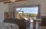 Grand master suite with pocket door, pool and ocean views
