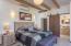Second guest room queen bed with bathroom barn doors