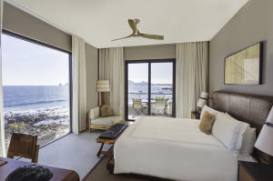 One of only two two-bedroom residences closest to the water with panoramic ocean views from the guest bedroom