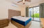 Master Bedroom with a glass door to the privacy of your completely walled back yard.