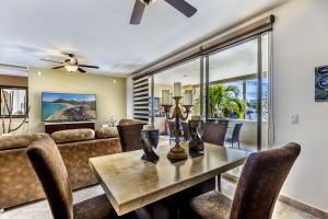 Gardenias 2nd floor unit with living room that feeds off the terrace wtih Pool, Golf and Ocean Views