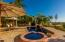 Large outdoor dining and BBQ area lend to even more open sun spaces with heated pool and jacuzzi
