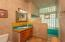 Guest bathroom, with shower and tub, colorful tile work.