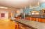 kitchen area, lots of counter top space, breakfast counter, dining area. Guest room in distance
