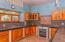 kitchen area, lots of counter top space, custom wood cabinetry