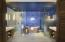 Spacious Bath with Jack and Jill sinks, rain shower, above ground copper bathtub, and closets