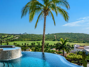 Heated infinity edge pool and Jacuzzi with Sea, Golf and mountain views
