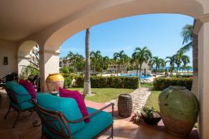 Garden level, private end unit walks out to the pool & the beach.