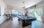 Game room adjacent to living room