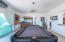 Billiard room, media room or even convertible to another bedroom. Complete with built in bar and sink