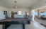 Billiard room/game room opens to spacious covered patio