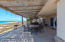 Expansive Palo de Arco covered patio for outdoor dining, living and entertainment