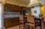 Large kitchen with high end appliances, island & walk in pantry