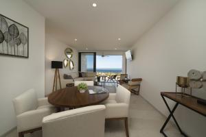 Brezza Building, Solaria Ground Floor Condo, Cabo Corridor,