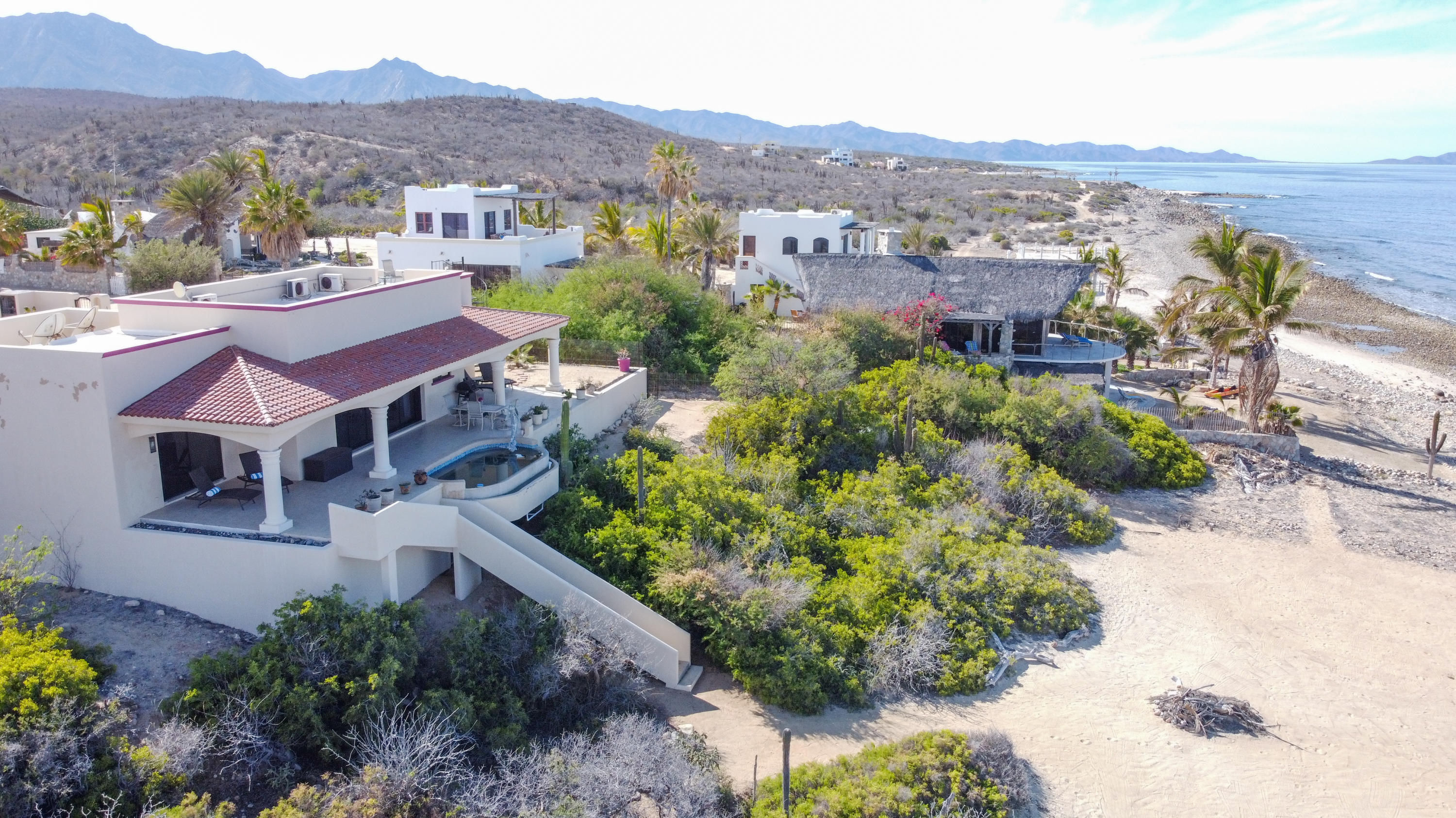 ** Seller is prepared to offer a $25k discount to purchase price for the construction of a new garage.  This offer is only available until November 31st 2021** This stunning turn-key house is on almost 1/2 acre lot. Unsurpassed views of ocean from every window. 2 ensuite bedrooms, open plan kitchen with island, large sitting room with pocket doors. Large covered patio area allows you to soak up best of Sea of Cortez: watch whales, dolphins & rays play.   Benefit from sandy beach area with sandy access to water.  Excellent snorkeling & safe for swimming & water sports.  High end finishings throughout: ash cupboards, granite kitchen counter.  Dipping pool with seating ledge allows you to survey the ocean while enjoying the tranquility that is El Cardonal.