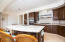 Gourmet kitchen, marble floors upgraded granite and custom hood fan