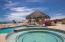 Shaded pool palapa with swim up bar