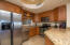 Granite counter tops, stainless appliances, alder wood cabinetry