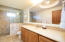 Walk in marble shower, marble counter, alder wood cabinetry