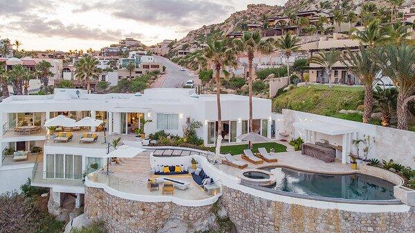 Impressively perched high over the Pacific Ocean in the gated community of Pedregal, Casa Nautilus provides its guests with some of the best views in Cabo San Lucas. You just have to step on to your patio to enjoy the attractions that bring thousands of people to Cabo each year. This newly renovated villa is located just a couple minutes away from downtown making it one of the more desirable locations in Cabo. Casa Nautilus provides an unparalleled vacation experience. You enter this contemporary villa through an immense wooden front door and are greeted by the sweeping ocean views. This villa's open concept living and floor-to-ceiling glass doors that span across the entirety of the living and dining rooms take full advantage of its location.