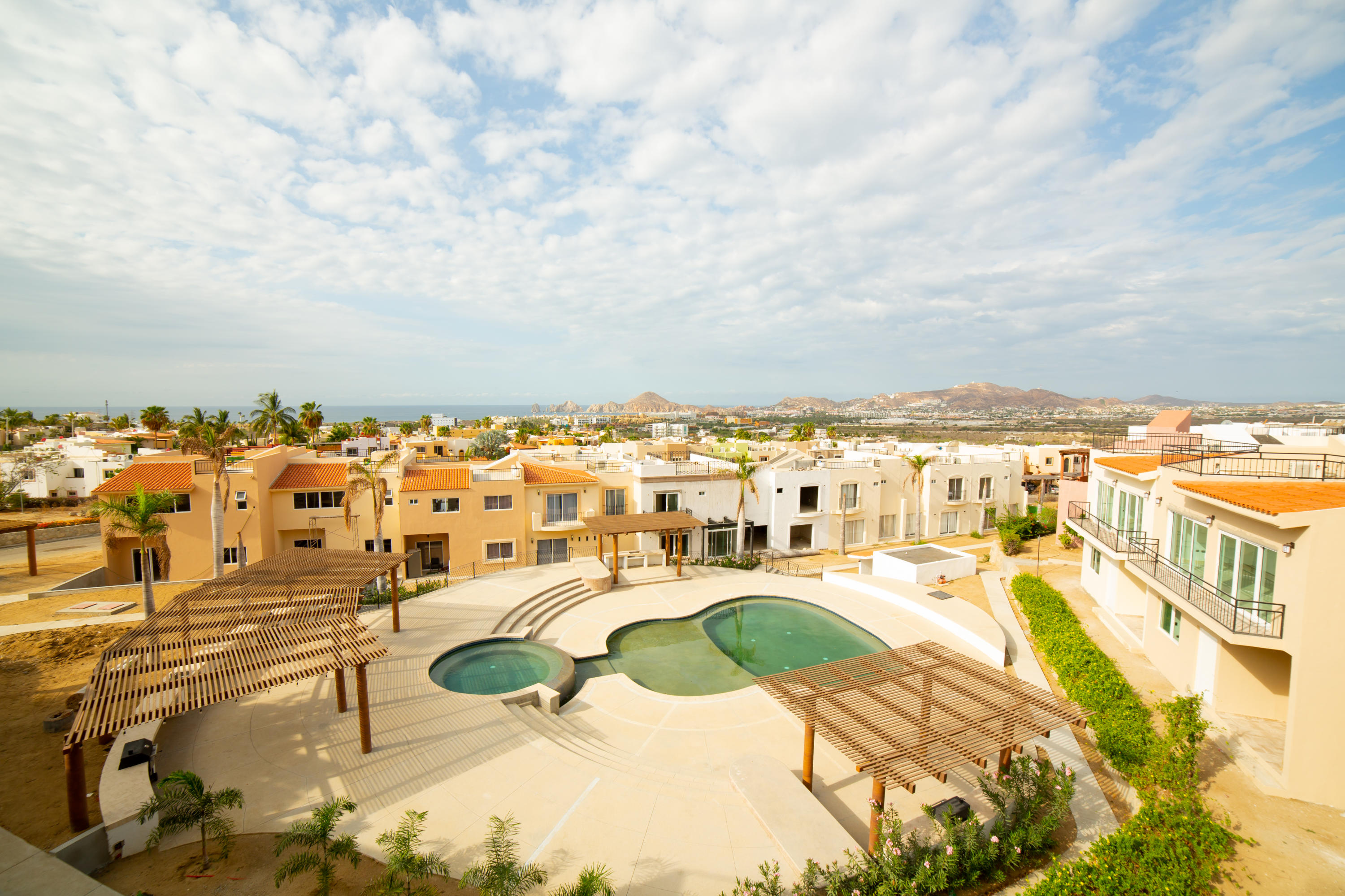 This is 1 of only 6 left out of 30 new beautiful homes in villas del tezal. Fully furnished turn key ready to live or rent. Massive 3 floor home offers plenty of areas to relax. Roof top hot tub to sip wine and enjoy the view and a grill to serve your guests delicious bbq'd food while entertaining. All with a gorgeous view. The photos do not do the view justice at all you need to come down and look for yourself. We have 6 to chose from...Come before we sell them all!!