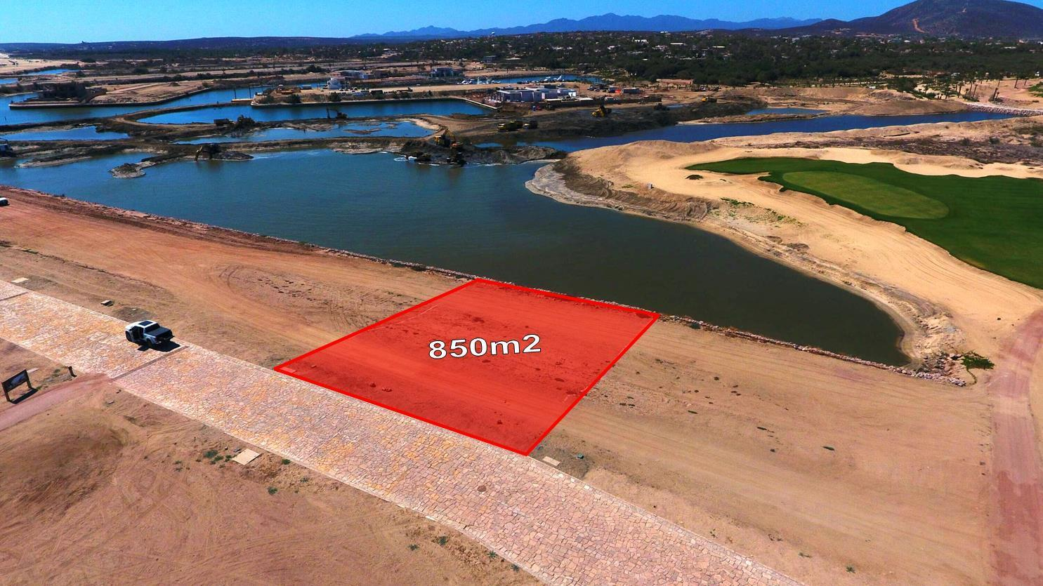 RARE RARE RARE....COSTA PALMAS MARINA LOT. Dock you yacht in your back yard!  850 sq mt flat lot with beautiful granite cobble stone roads. What an amazing opportunity to have a beautiful golf course right across the channel from you and having your yacht docked in between. These lots dont come around often and so this one wont last long. Ready to build your dream home?