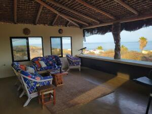 The palapa covered terrace doubles the living space