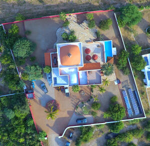 This aerial view of the property highlights 2,500 m2 of land contained within a secure property wall.