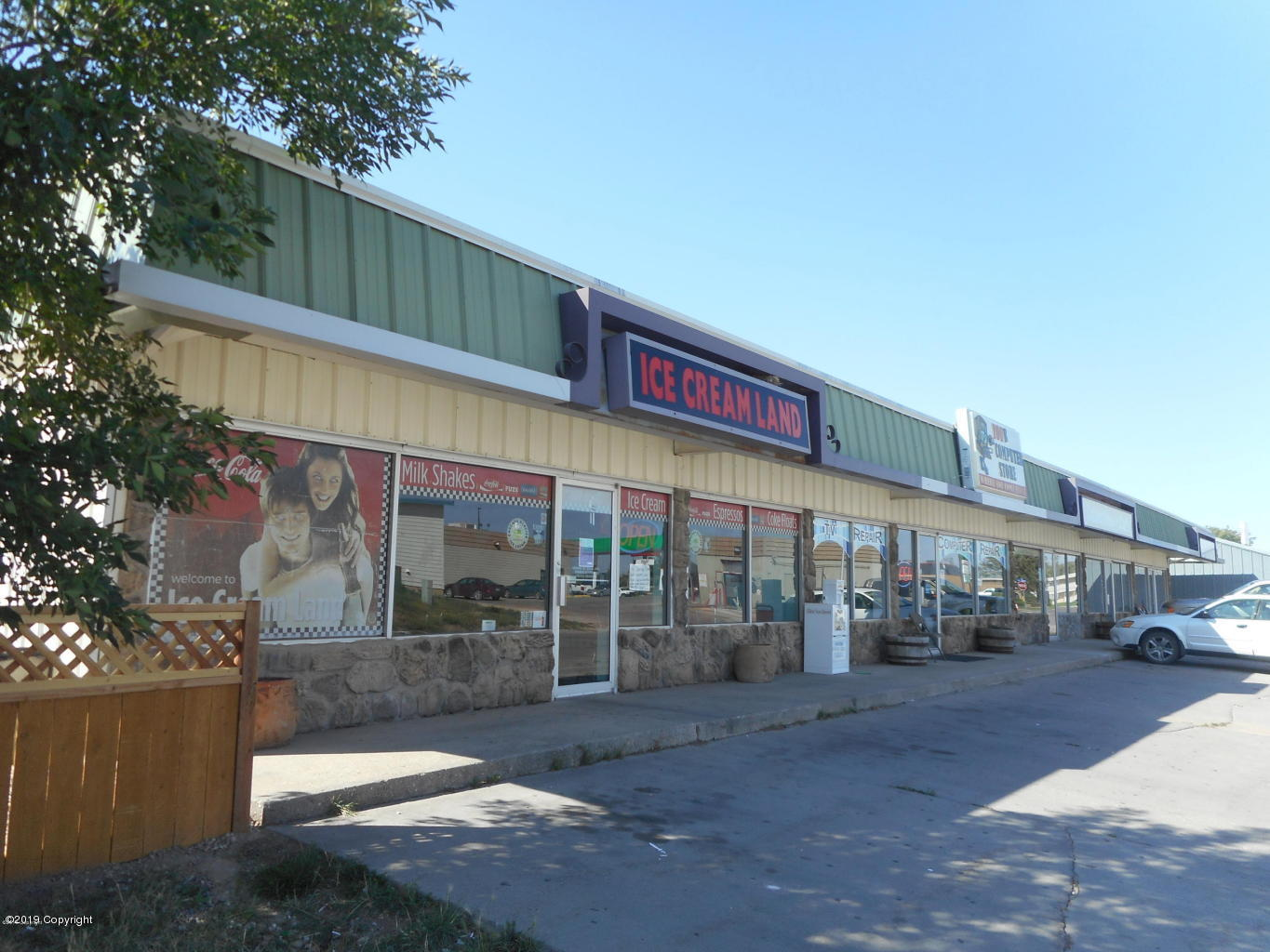 Looking for investment to provide some income?  This 4800 square foot neighborhood shopping center is just for you.  There are three quality tenants in this fully leased building.  An ice cream shop, computer repair store and day care center.  All three businesses have leased in this location for minimum three years.    The property is almost 1/2 acre lot and has a 20'x30' storage building.  Plenty of parking behind building.