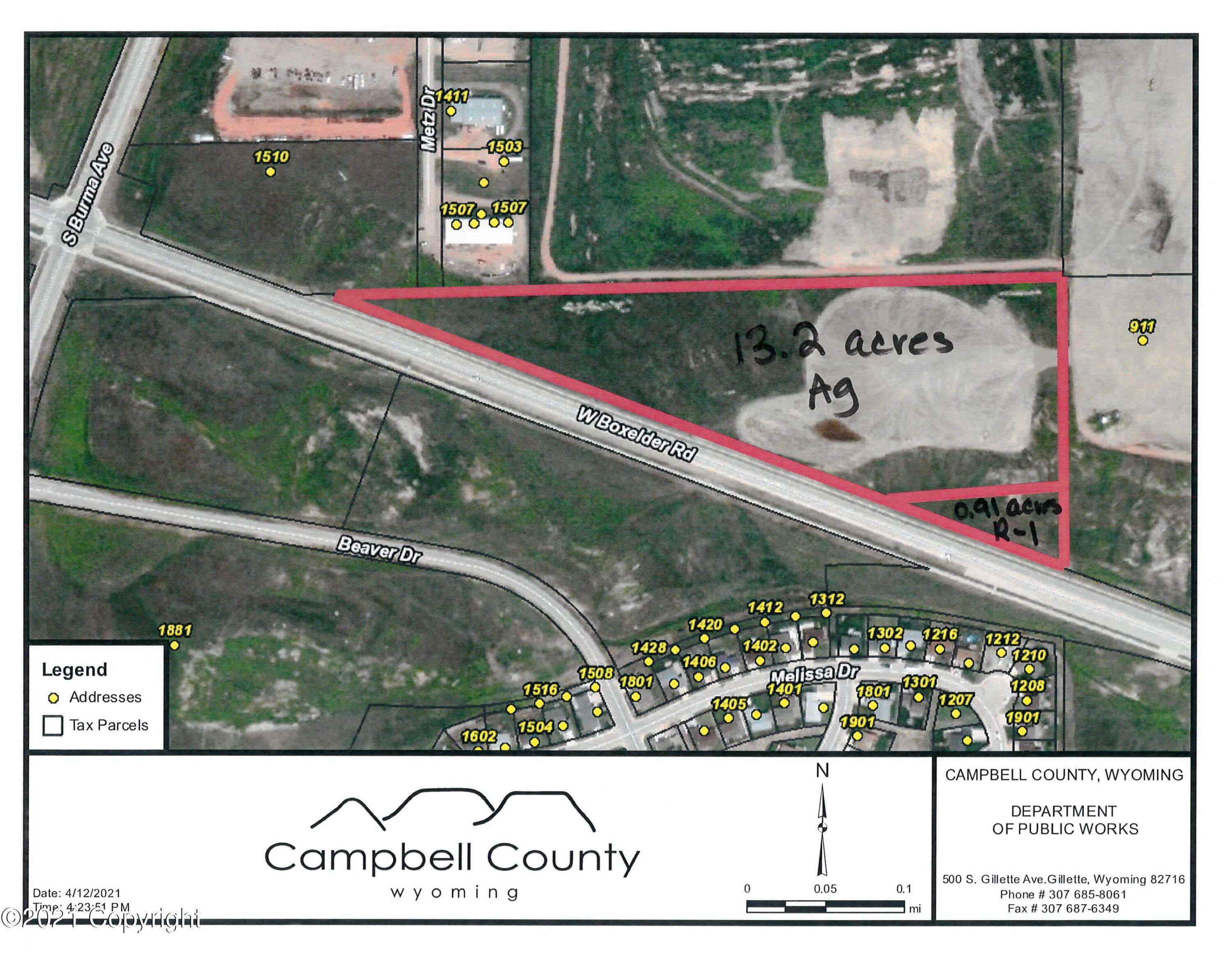 Located on the north side of Boxelder Rd. near Burma Rd.  13.2 acres county land zoned Ag and .91 acres zoned R-1 within city limits.  Buyer could apply with county/city to change zoning.   City water and electric along south side of property Would require annexation to tap into city water/electric.