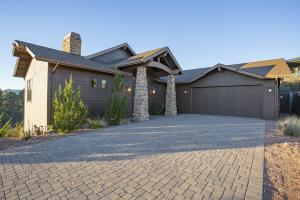 Paver Driveway to over sized two car garage with room for cars, golf car & bikes.
