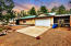Large 4 car + GARAGE with carports on either side! Home is a separate structure to the left.