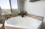 Soaking tub with panoramic view.