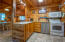 Cutest Cabin Kitchen open to dining area