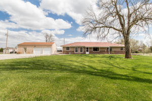 Great hobby farm with over 14 fenced acres, with barn and stalls. Also, a large detached garage, with additional workshop space.