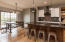 Awesome, modern kitchen featuring slate appliance package, dark stone counters, room for informal dining