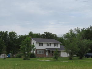 Centralia Schools - Audrain County!!  4 bedroom two-story home with unfinished basement on 10 acres m/l on blacktop.  Main level provides large living room, convenient kitchen with dining area and den.  4 bedrooms upstairs with 1.75 baths.  Sit from the large deck and enjoy the peace and quiet of country living with an abundance of wildlife!
