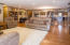 Gleaming hardwood floors throughout living room, dining room, and kitchen