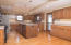 Expansive island with full sink and 4 Lazy Susan's throughout kitchen