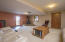 Family room down with wood burning fireplace on raised, tiled hearth