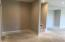Second living area - access to unfinished storage and John Deere doors