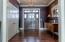 Enter to gleaming hardwood floors, 9' ceilings throughout.
