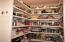 Huge walk-in pantry in addition to cabinet storage