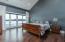 Vaulted master bedroom wood slat ceiling