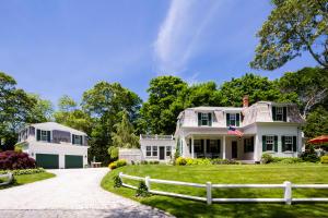 Iconic, Cotuit village Mansard roof family retreat in premier location.