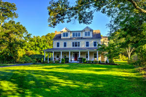 Sited on over a acre of land just steps from the beach.